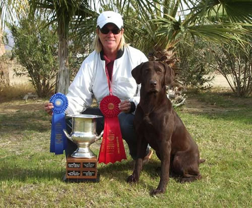 Bones with trainer Patti Kiernan after winning the Qualifying at the San Diego Retriever Club's field trial in February 2006 and placing 2nd in the Qualifying at the California South Coast Club's field trial in March 2006.